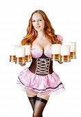 stock photo of stein  - Beautiful oktoberfest young sexy woman wearing a dirndl with six froth beer mugs isolated on white background - JPG