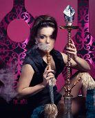 pic of hookah  - Beautiful woman smoking hookah in nightclub - JPG