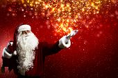 foto of christmas claus  - Santa Clause with gift bag behind shoulders - JPG