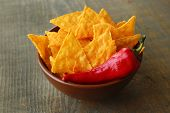 picture of nachos  - Tasty nachos in color bowl on wooden background - JPG