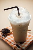 picture of frappe  - Iced Coffee and coffee beans on wooden - JPG