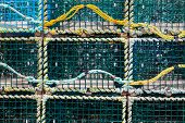 foto of lobster trap  - Modern Lobster and Seafish traps closeup during the day - JPG