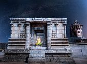 foto of karnataka  - Woman doing meditation in ruined temple at night sky with Milky Way in Hampi Karnataka India - JPG