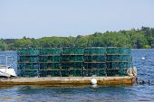 stock photo of lobster trap  - Lobster traps at a fishing pier on Littlejohn Island Yarmouth Maine New England - JPG