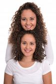 foto of identical twin girls  - Real monozygotic twins with natural stop curls isolated over white background - JPG