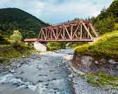 foto of trestle bridge  - Railroad trestle over the mountain river Carpathians - JPG