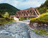 stock photo of trestle bridge  - Railroad trestle over the mountain river Carpathians - JPG