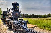stock photo of locomotive  - A vintage locomotive steam engine with copy space - JPG