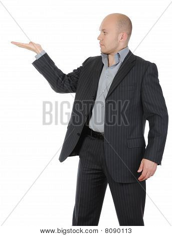 Businessman In A Suit Holds Her Hand, Palm Up.