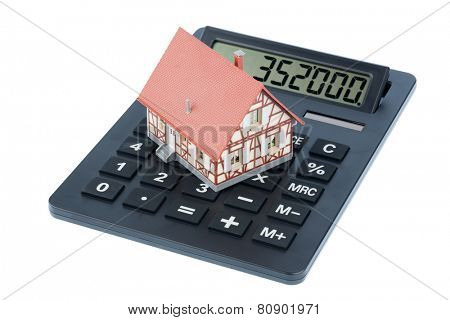 residential building on a calculator, photo icon for house purchase, costs and savings
