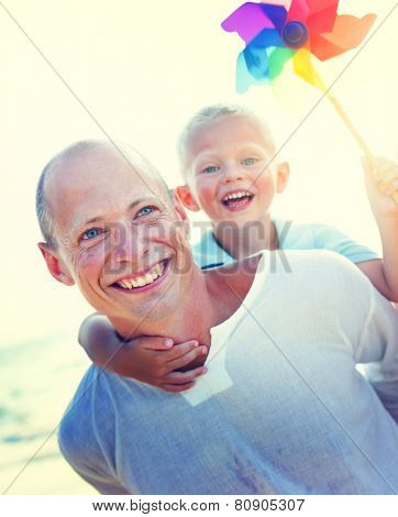 Family playing on the beach.Father Son Fun Relaxation Family Bonding Concept