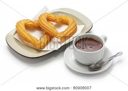 heart shape churros and hot chocolate on white background, spanish breakfast