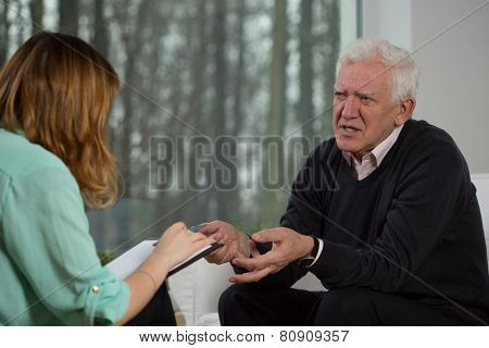 Elderly Patient Talking With Psychotherapist