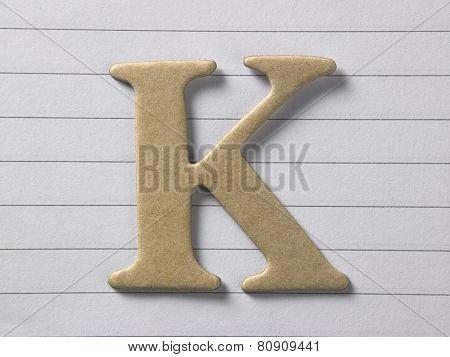 close up of alphabet k on single line book