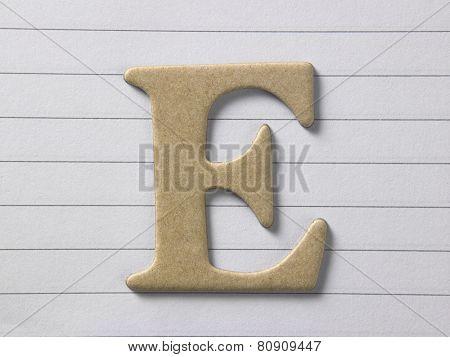 close up of alphabet e on single line book