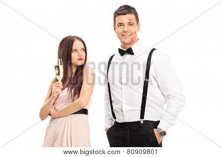 Jealous girl looking at man covered in kiss marks isolated on white background