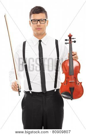 Vertical shot of a male violinist holding a violin and a bow isolated on white background