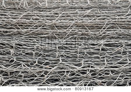Steel Iron Raw Wire Fence Texture In A Warehouse