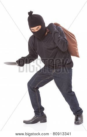 Thief with bag and holding knife