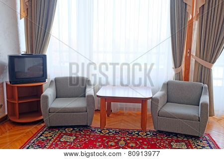 two chairs in the suite room at motel