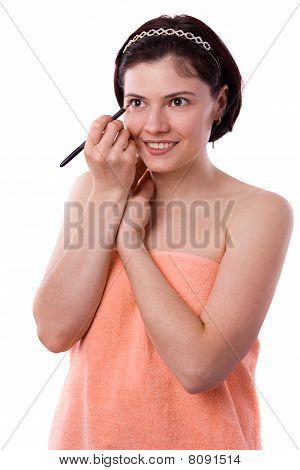 Brunette Woman Using Eyeliner On Her Eyes