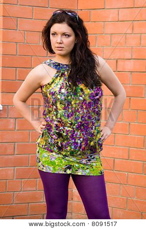 Beautiful Woman In Brightly Coloured Dress Outside.