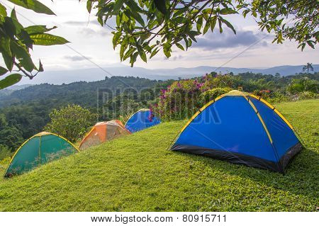 Camping Tent In Campground At National Park With Sunrise