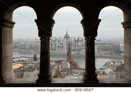 Hungarian Parliament on the embankment of the Danube seen from the neo-Romanesque terrace of the Fisherman's Bastion in Budapest, Hungary.