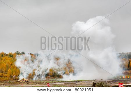 Russian tank T-90 hides in smoke screen from enemy
