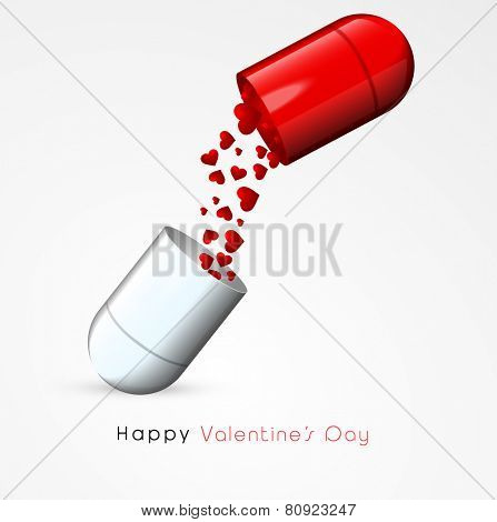 Red hearts coming out from a glossy capsule pill on grey background for Happy Valentines Day celebration.