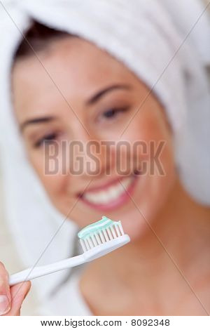 Woman Holding A Toothbrush