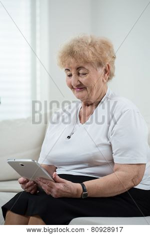 Modern Grandma Using Tablet