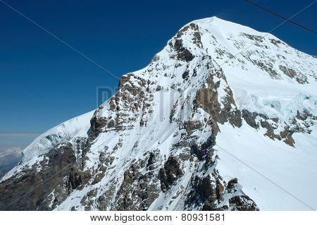 Monch Peak In Alps In Switzerland