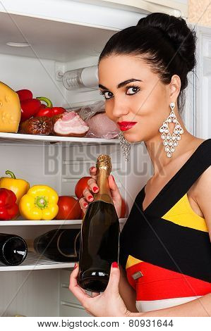 brunette woman and a fridge