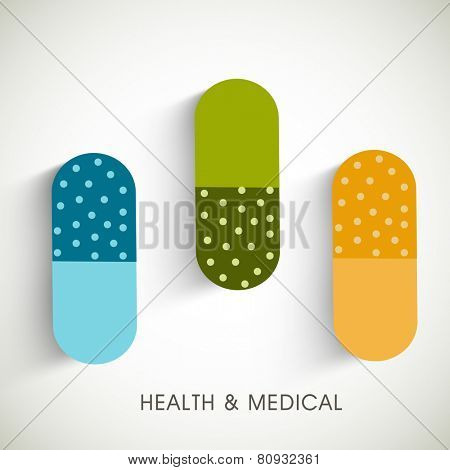colorful capsules on abstract background.