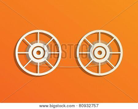 Film reels on orange background.