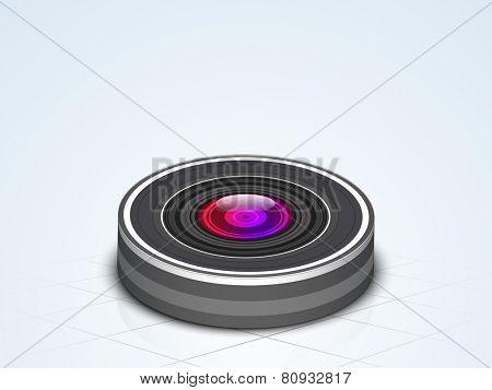 Photo camera lens on blue background.