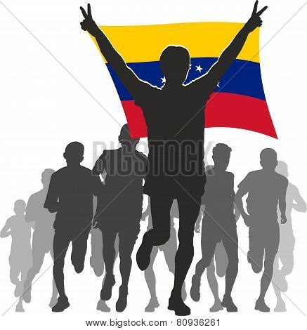 Athlete with the Venezuela flag at the finish