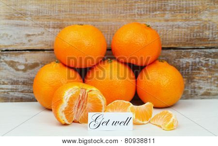 Get well card with mandarines with rustic wood background