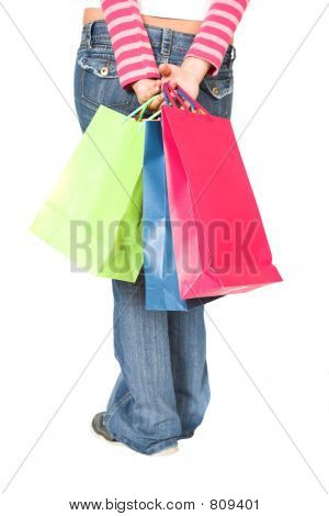 girl in jeans with shopping bags