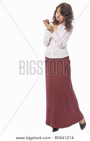 Full Length Portarit Of Thinking Caucasian Female With Long Curly Hair Holding Sea Shell. Isolated O