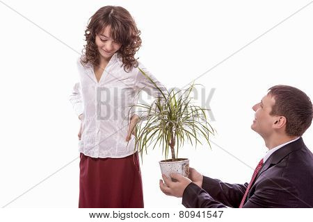 Portrait Of Caucasian Couple Together Having Fun. Allegoric Flower Gift Presentation To Female. Isol