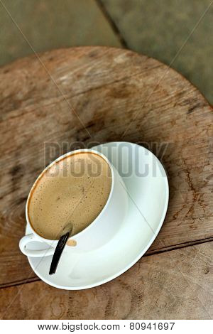 Espresso Coffee In A White Cup On A Wooden Table.