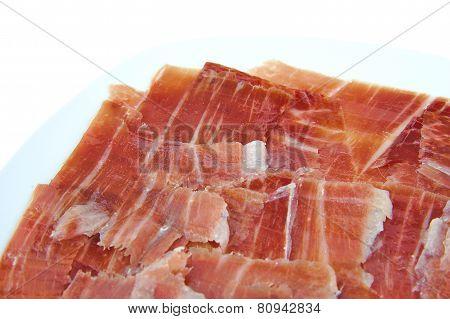 Closeup of spanish serrano ham on white background.
