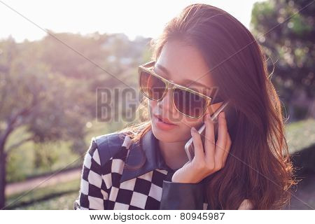 Portrait Of Beautiful Woman Listening On Mobile Phone Use For People In Modern Digital Connecting Te