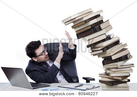 Male Manager With Falling Book On Desk