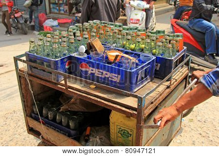 PATAN, NEPAL - APRIL 2014 : A street vendor selling Fresh Lime Soda in Patan, Nepal on 13 April 2014. Fresh lime soda is a beverage in Nepal which consists of lime juice, sugar and club soda