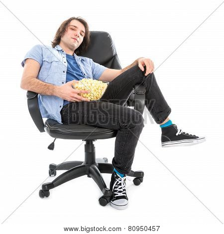 Lazy Man Sitting In Armchair With A Bowl Of Pop Corn