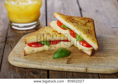 fried toast sandwich with mozzarella and cherry tomatoes