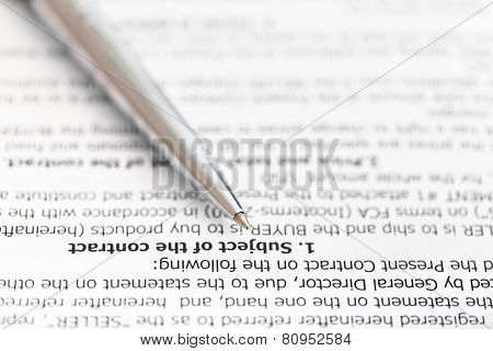 Silver Pen On Page Of Sales Contract